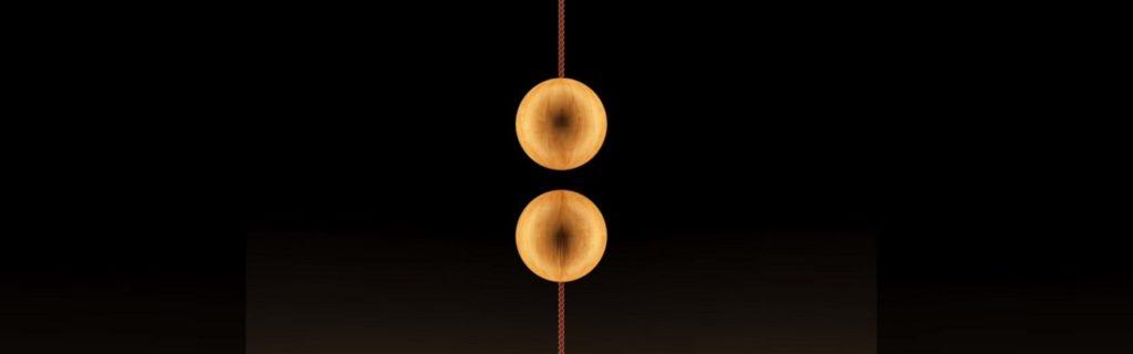 interruttore fatto da due sfere di legno e magneti Hend Balance